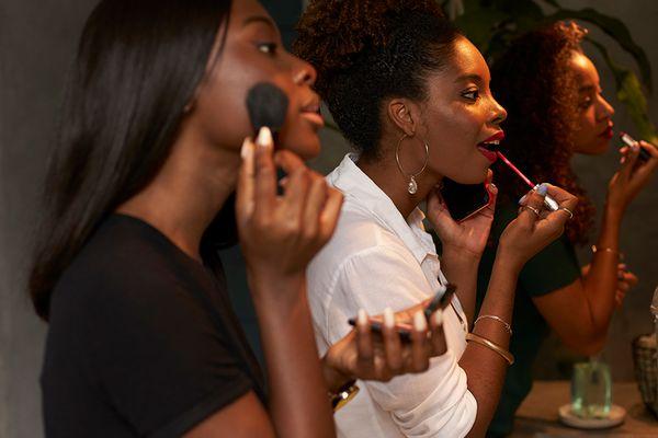 Women applying makeup
