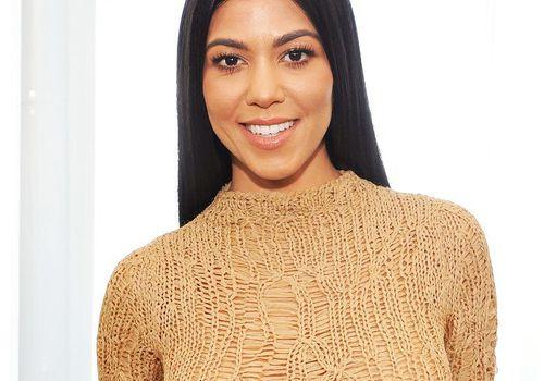 Kourtney Kardashian in a tan sweater