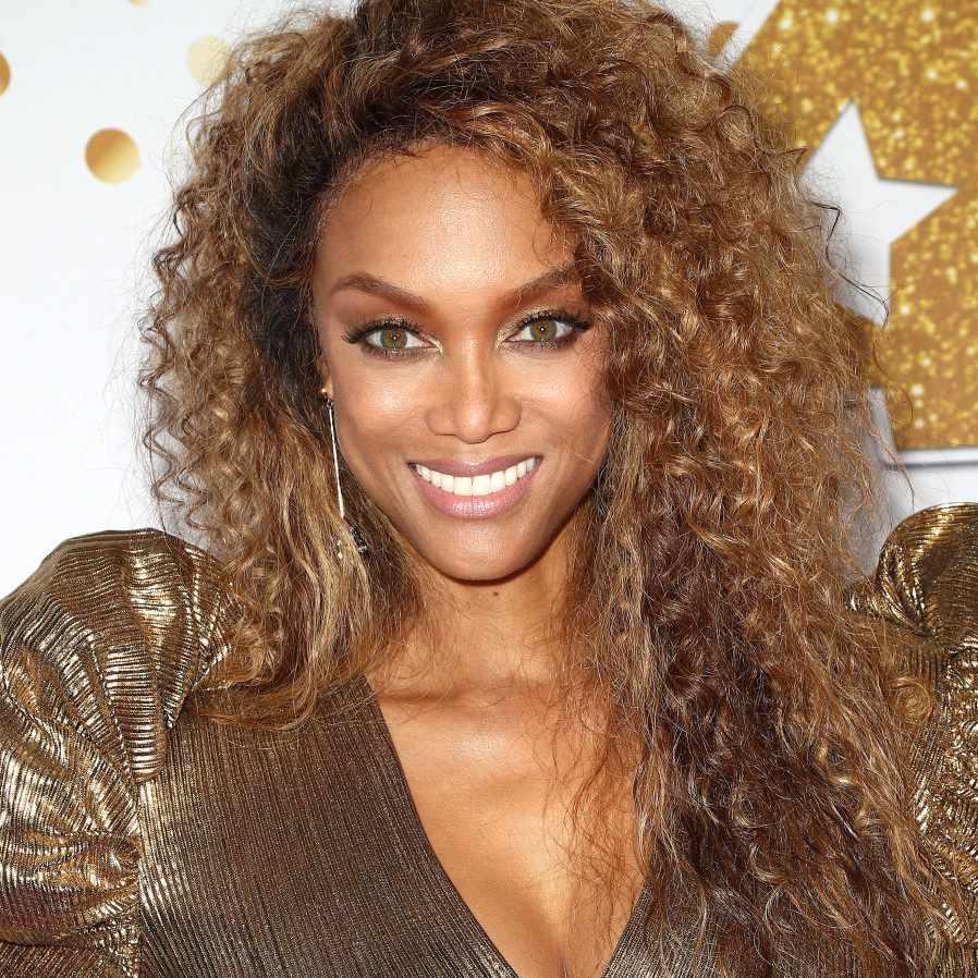 Tyra Banks long curly hair