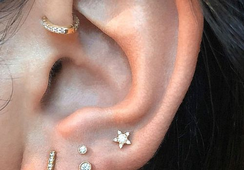 woman with a high placed lobe piercing