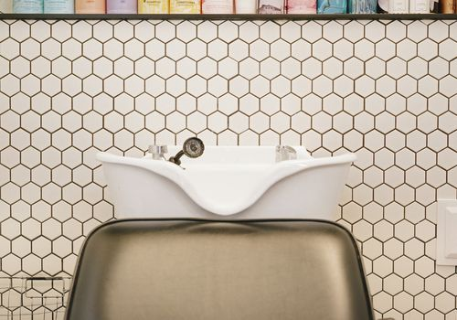 hair sink against honeycomb tiles in a salon