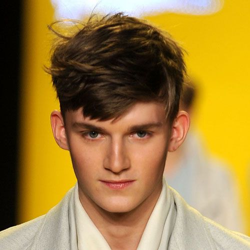men's haircut with short sides and a long top
