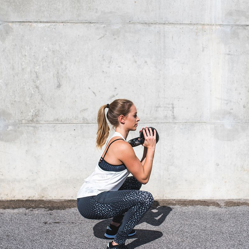 person doing kettle bell squat
