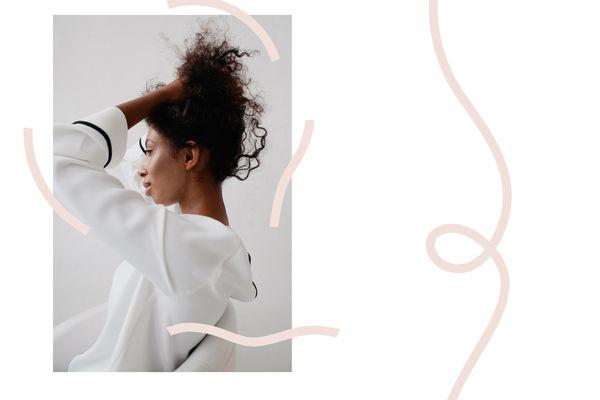 woman touching her hair