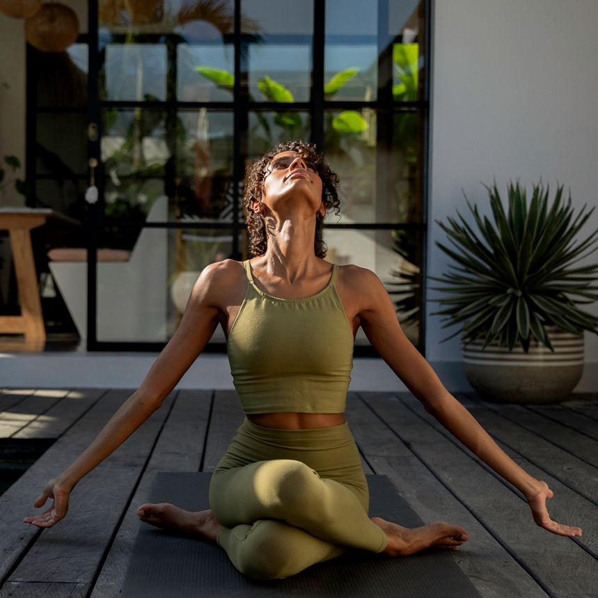 person does yoga on patio