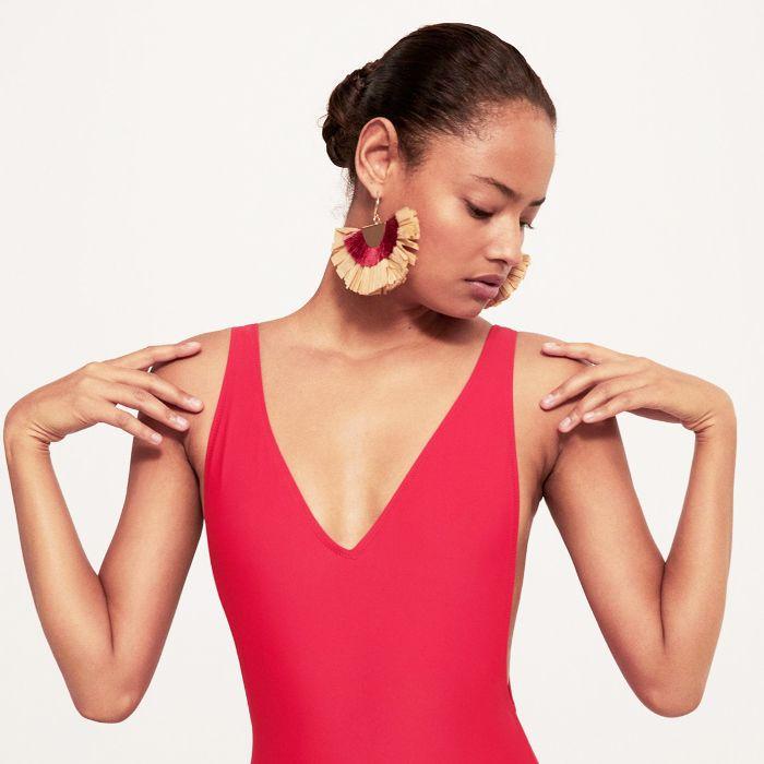 best sun cream: woman in red bikini