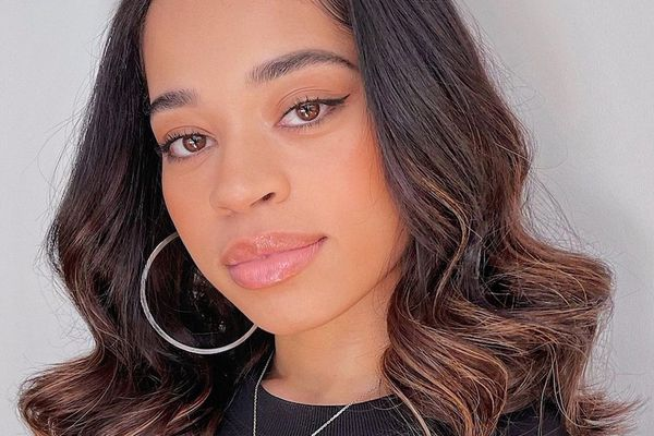 Ella Mai with a sew-in hairstyle.