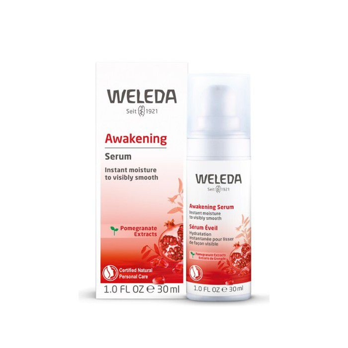 Bottle of Weleda Awakening Serum next to product box on a white background.