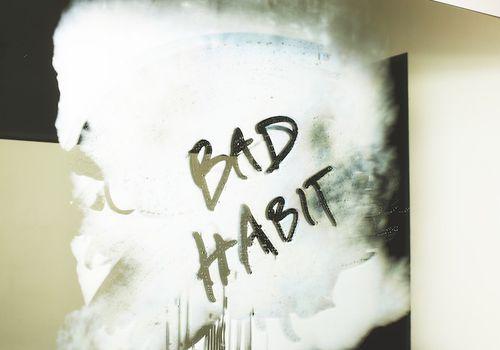Bad Habit written in foggy mirror