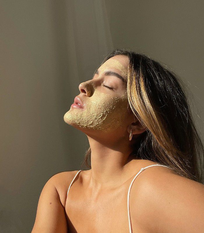 Woman with an exfoliating face mask
