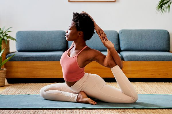 person does yoga pose in living room