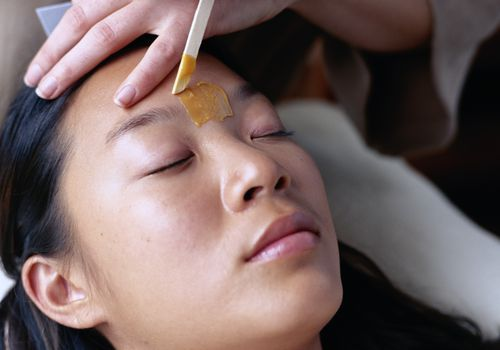 woman getting eyebrows waxed