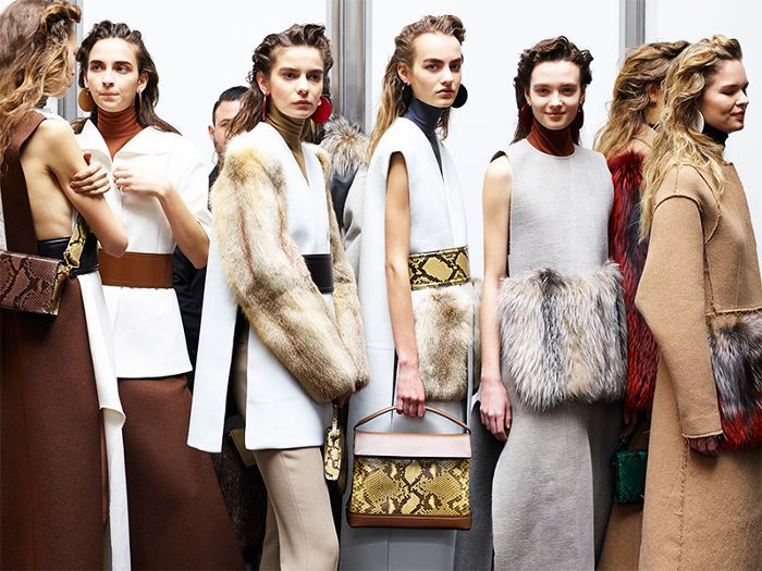 How to tan in winter: models with tanned skin and winter coats