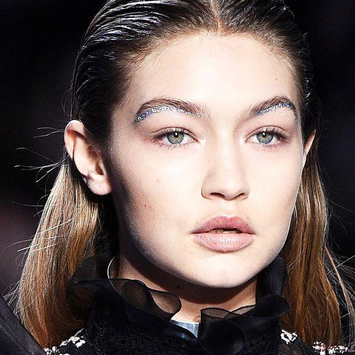 how to wear glitter makeup: gigi hadid with glitter brows at giambattista valli