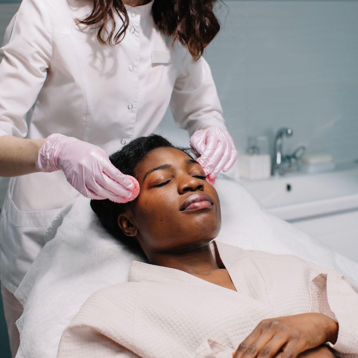 black femme getting a facial