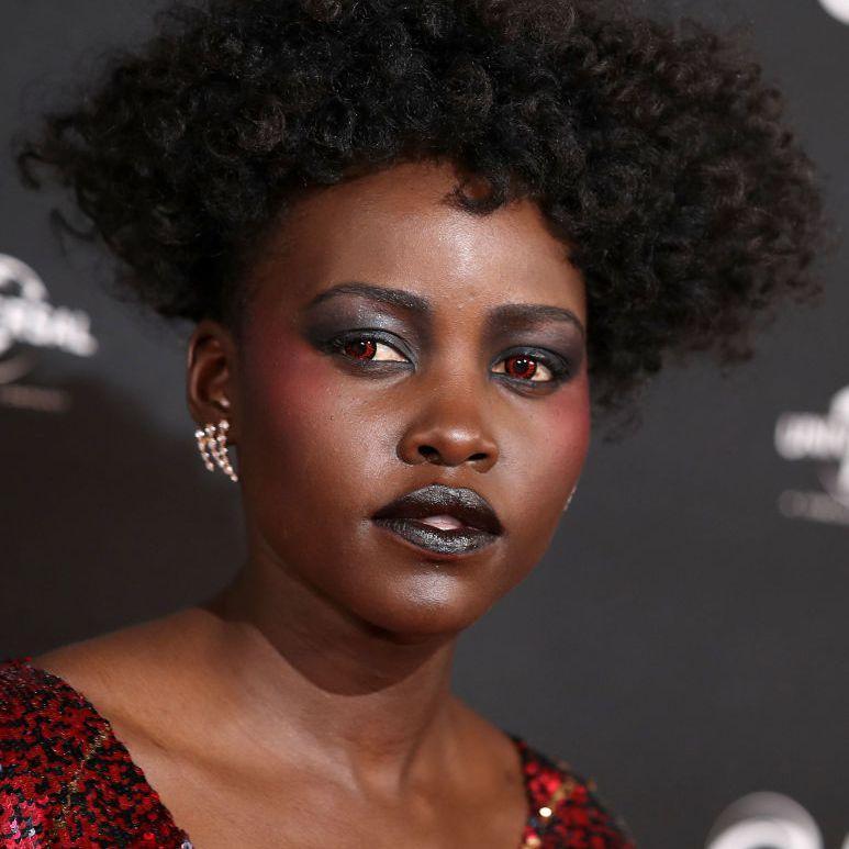 Lupita Nyong'o natural curly pixie