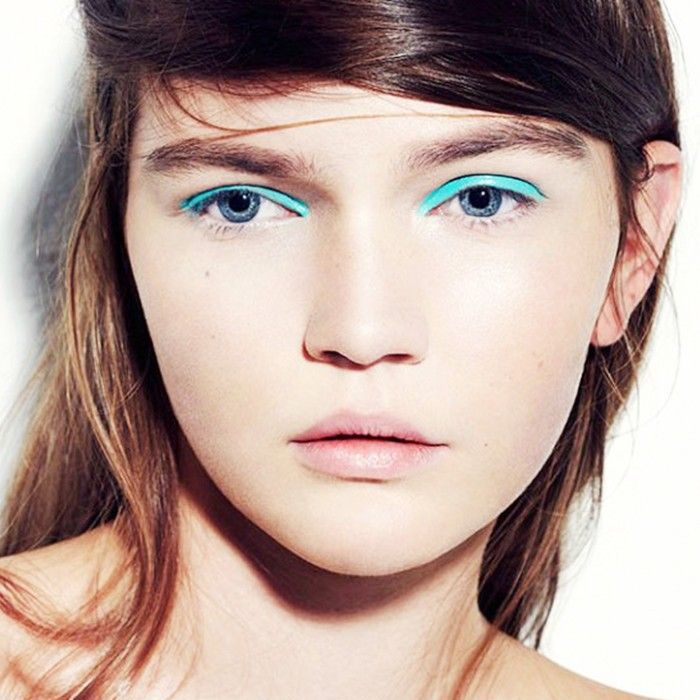 Woman wearing bright aqua eyeliner