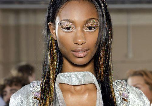 Model wearing glitter makeup