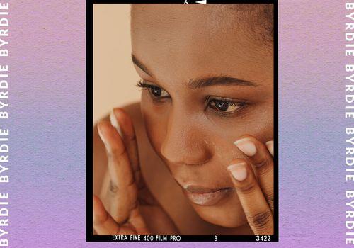 woman applying cream to dry skin around nose