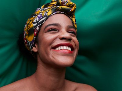 portrait of smiling person on green cloth