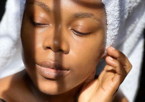 woman with glowing skin in towel