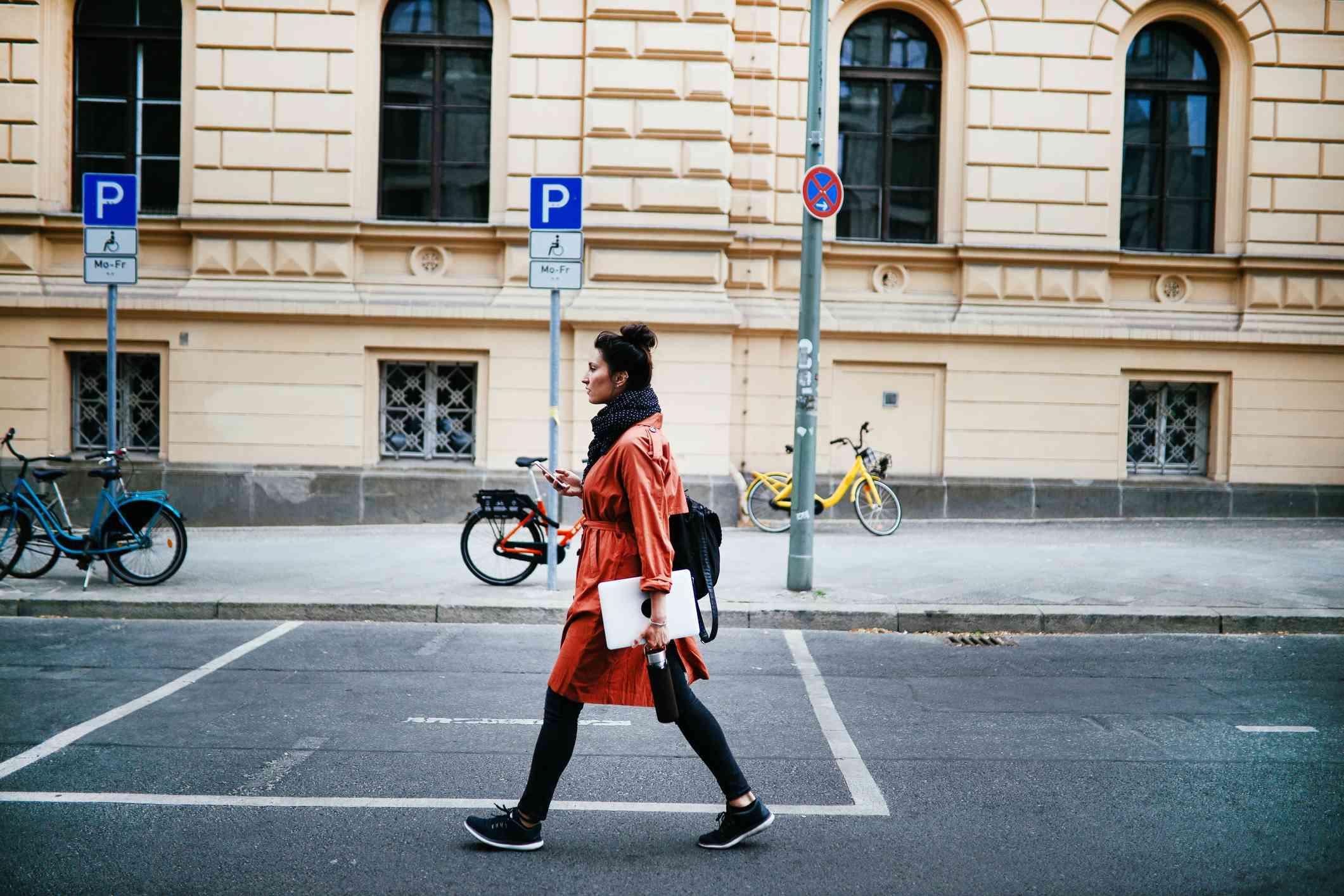 Woman walking in Berlin.