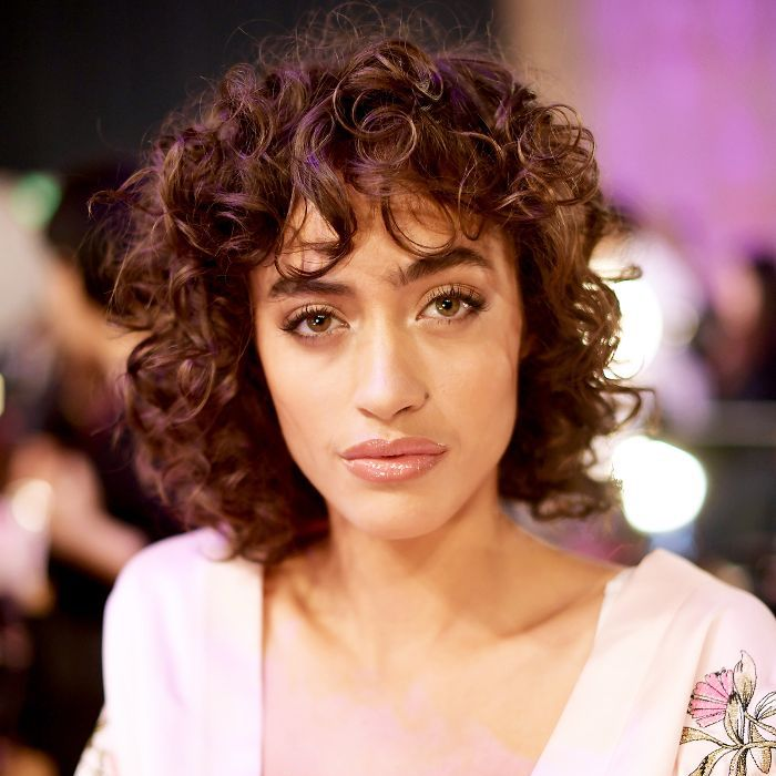 6 Ways To Effortlessly Rock Curly Hair With Bangs