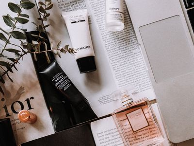 beauty products on a desk with computer