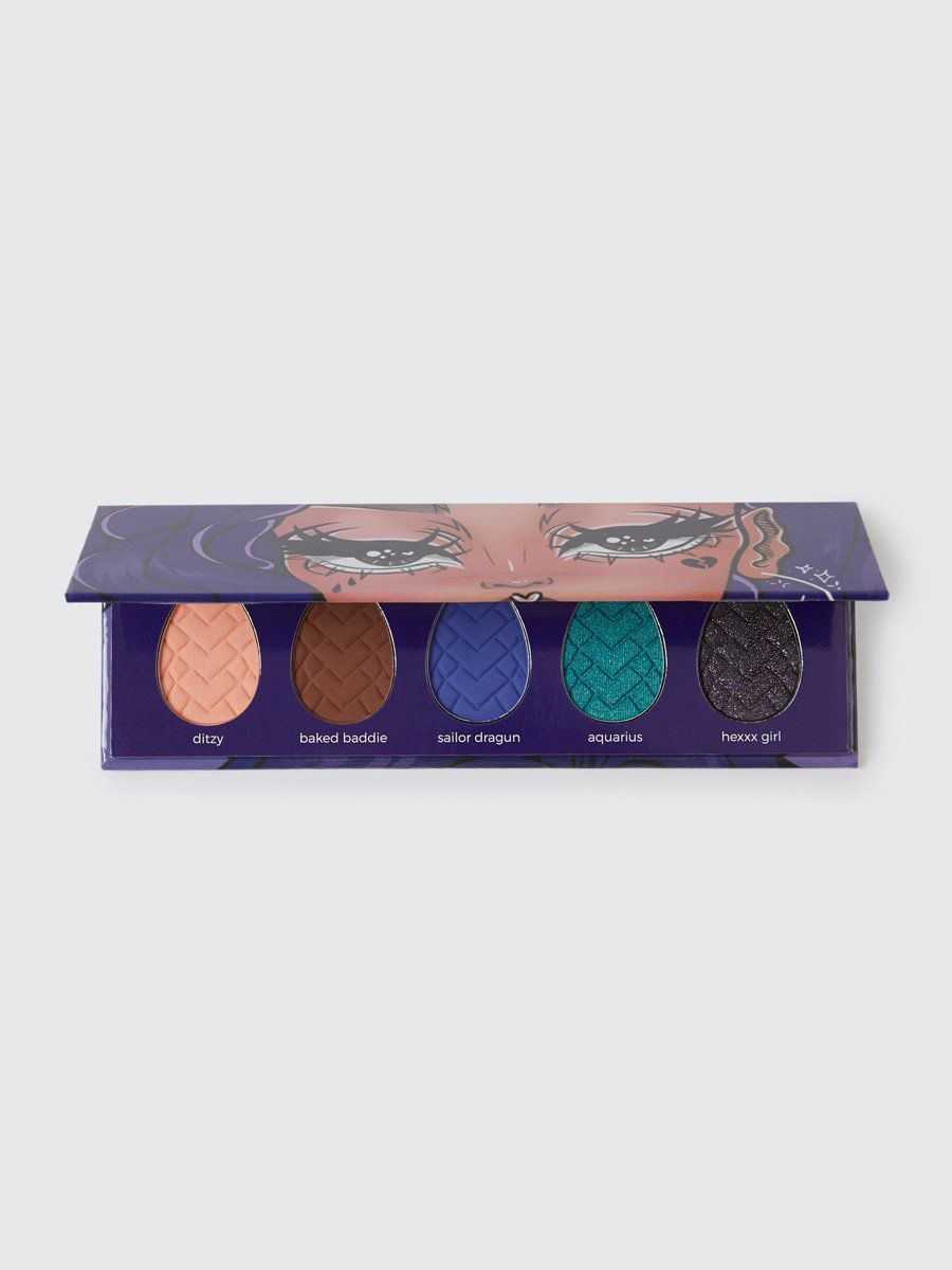 navy palette with 5 egg-shaped pressed powders
