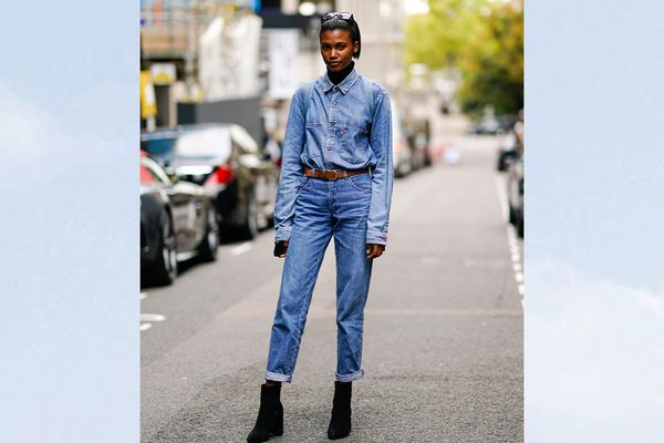 Woman wearing denim top and jeans