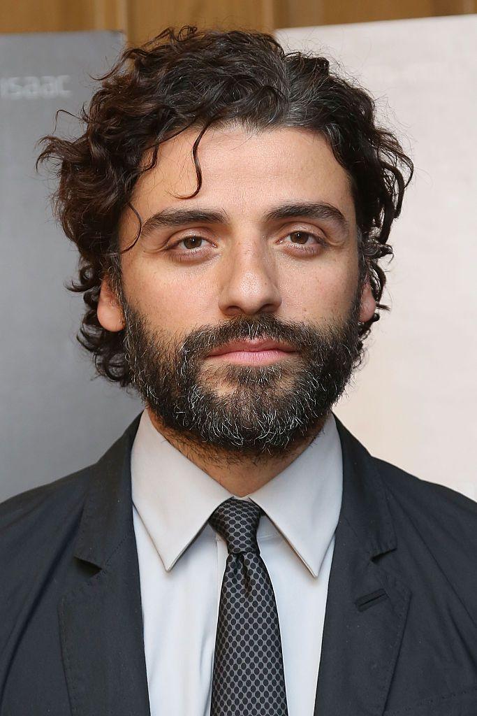 Oscar Isaac with long hair and a beard