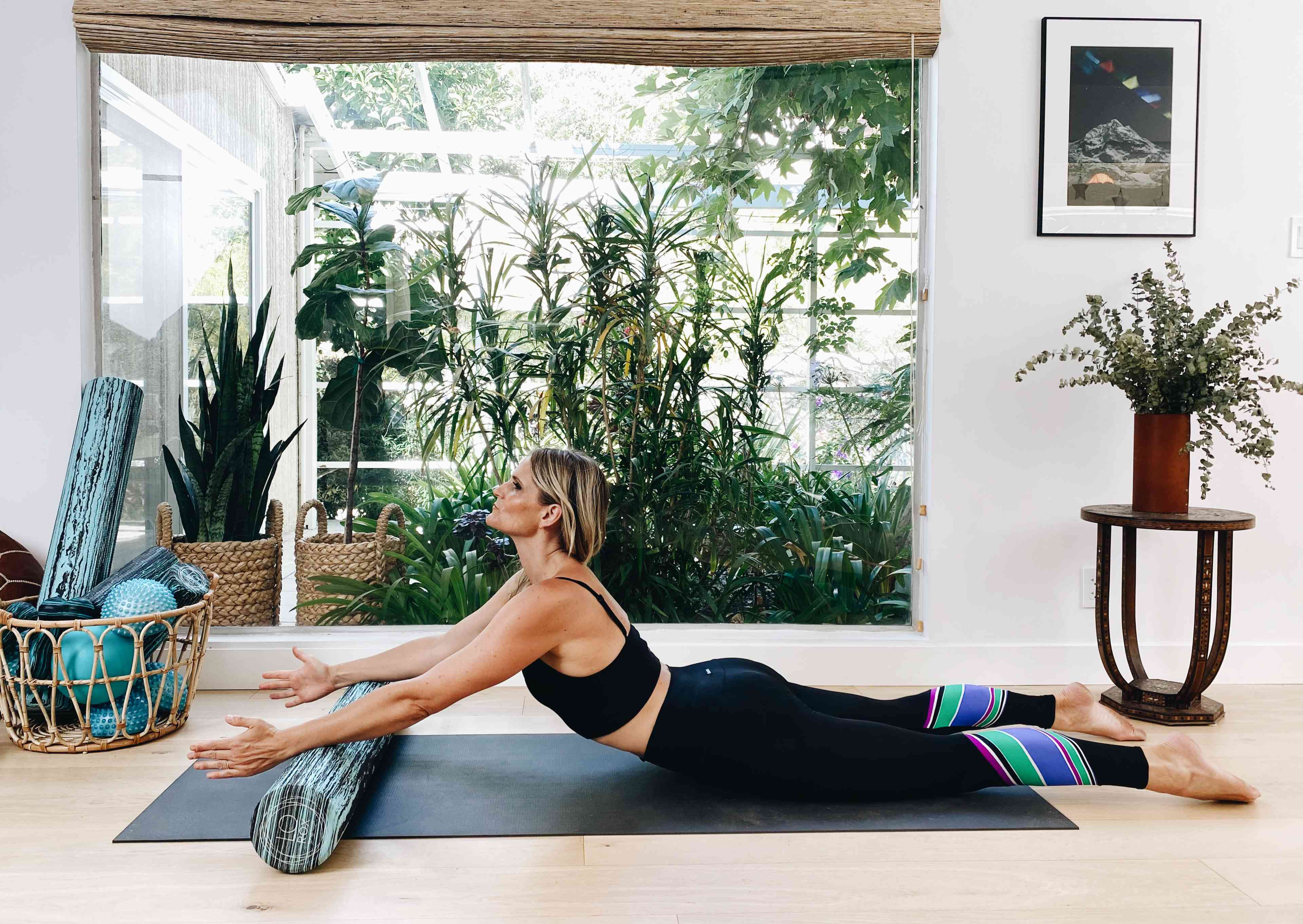 Rolling swan exercise with foam roller