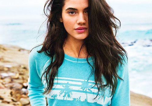 woman wearing a palm tree sweatshirt