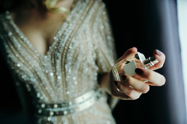 woman spritzing perfume