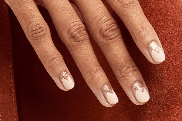woman with rose gold and gold manicure