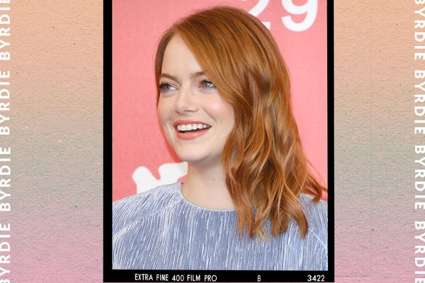 Emma Stone smiles on the red carpet