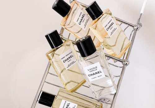 bathtub tray of chanel perfumes