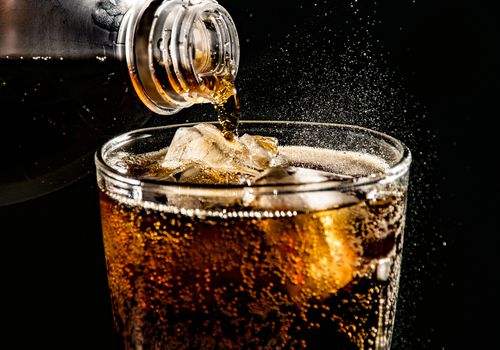 Coke being poured into glass