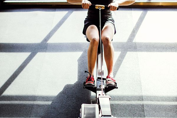 person rowing on machine