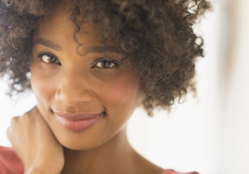Woman transitioning to natural hair