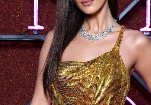 Bella Hadid with gold dress and bold necklace