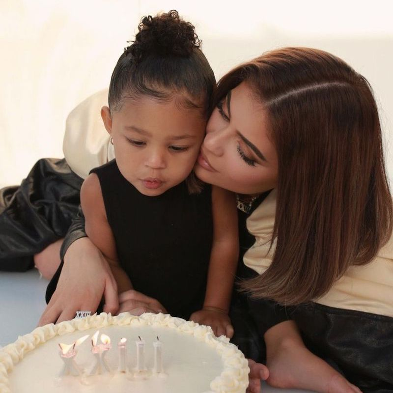 Kylie Jenner with baby Stormi and birthday cake