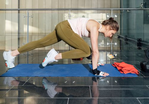 Woman performing mountain climbers