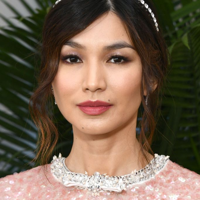 Gemma Chan loose updo with thin, sparkly headband