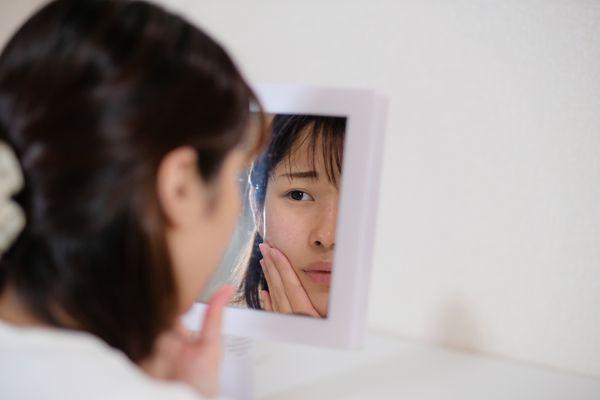 Woman taking care of rough skin