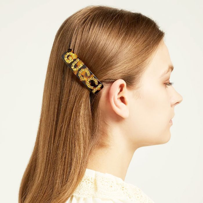best hair accessories: woman wearing Gucci hair slide