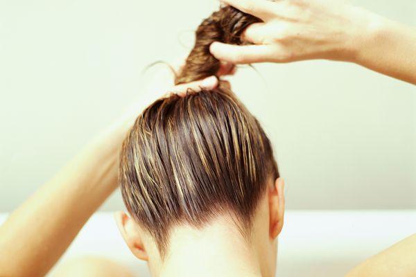 woman twisting hair
