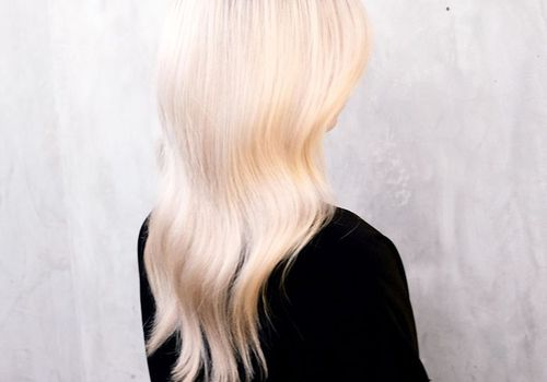 Back of woman with bleached blonde hair