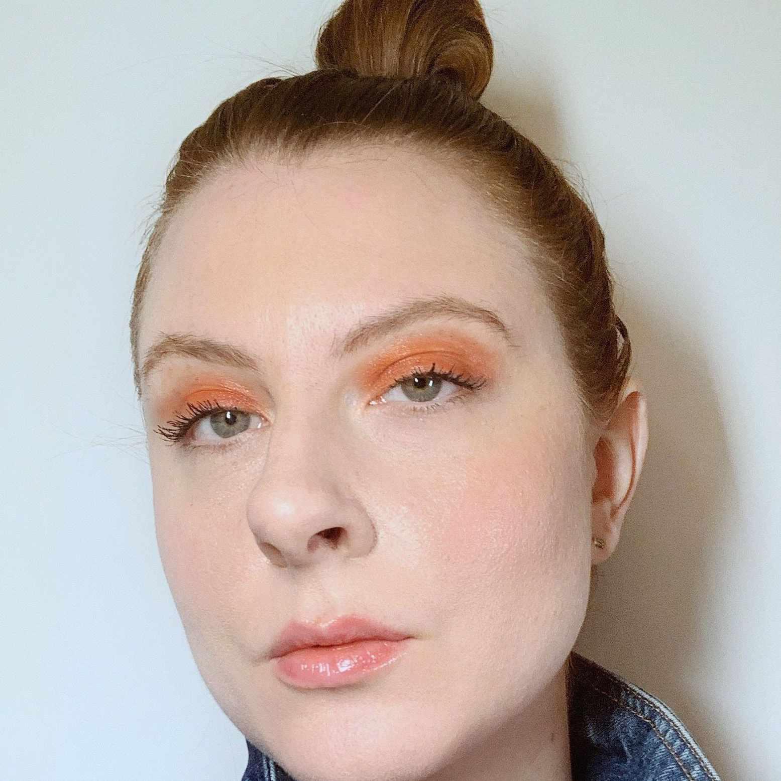 woman wearing simple orange eyeshadow