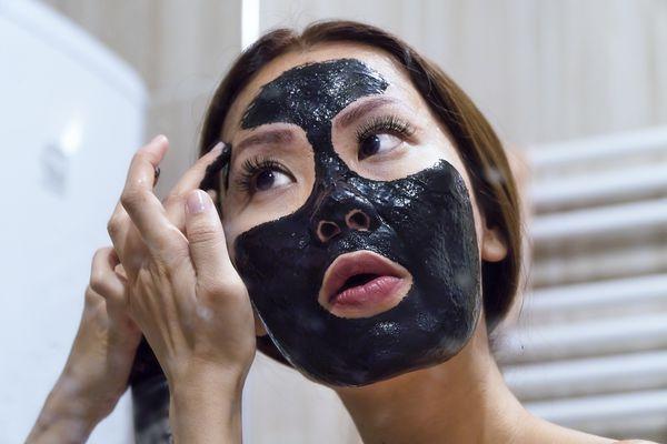 woman applying peel off mask
